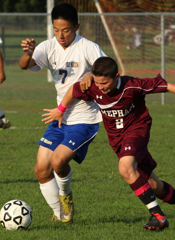 East Meadow's James Lim, left, and Mepham's Colin Vandewater vied for a loose ball during last Friday's 2-2 deadlock.