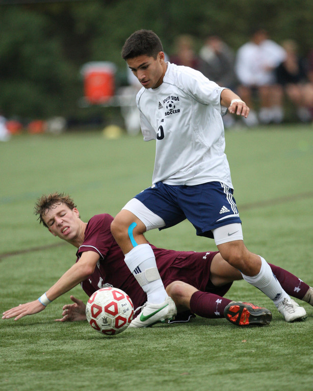 South Side's Alessandro Pugliese avoided a tackle attempt by Garden City's Patrick Keogh during the Cyclones' 1-0 home victory on Oct. 3.