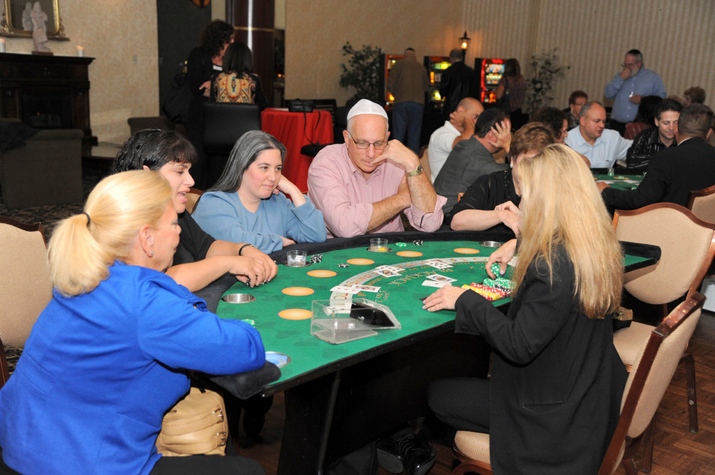 Village Trustee Ed Oppenheimer, above, was on hand at the Temple B'nai Sholom-Beth David casino night to honor his fellow trustee Michael Sepe.