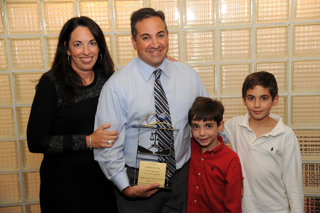Trustee Michael Sepe, with his wife Alyssa, and his sons, James and Jack.