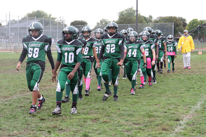 The Senior Hornets team takes the field for the Homecoming game.