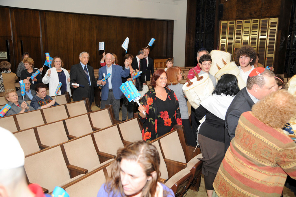 Temple Beth Am congregants danced with the Torah to celebrate Simchat Torah, which marks the completion of the annual Torah-reading cycle.