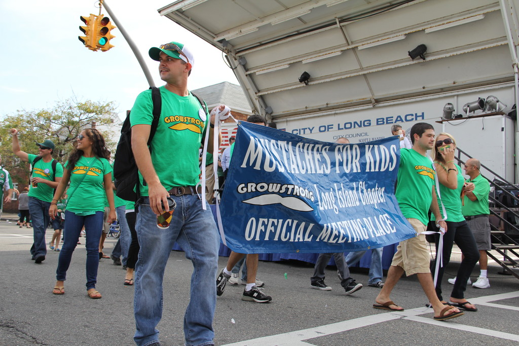 The Long Island chapter of Mustaches for Kids marched in last Saturday's Irish Day parade.
