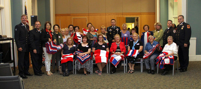 Stitches from the heart members, along with members of the Lynbrook amd Floral fire departments and the military, gathered for a photo at the event. They are pictured with some beautiful lap robes that they made