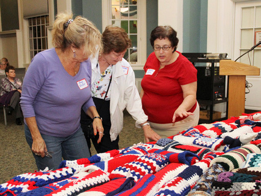 Amy Holler, Geraldine Coney and Roberta Lutz admired the workmanship of the blankets.