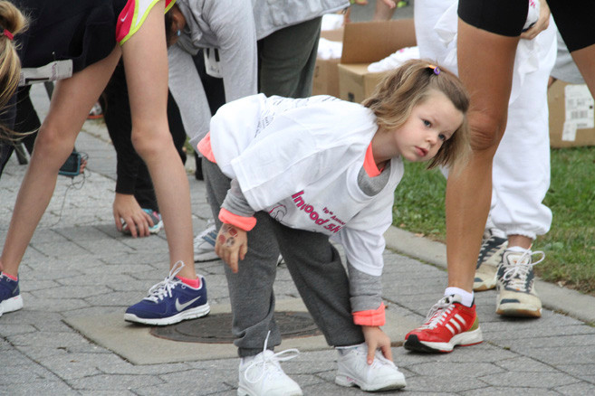Pumpkin Tot Trot participant Piper Ogden warmed up before the children�s race that ran after the start of the 5K run.