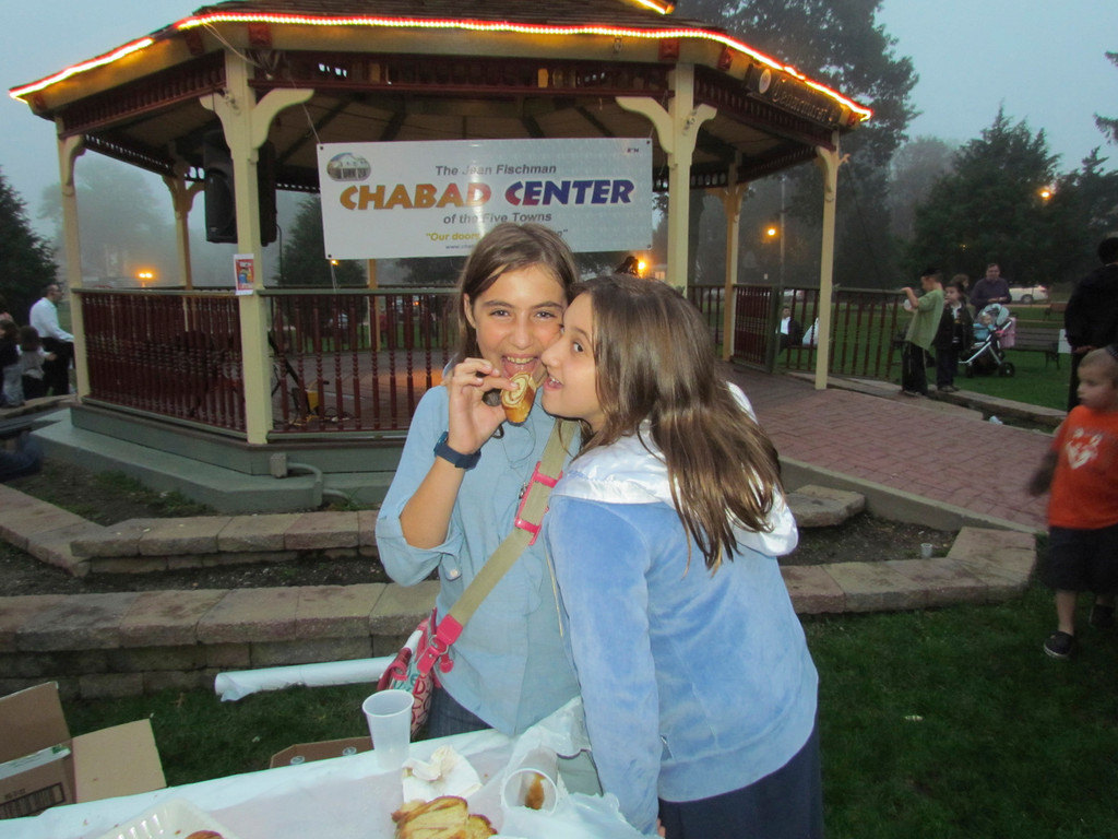 Chabad's Sukkot party in the park brought family and friends together to celebrate the holiday. Friends, Shifra Pewzner,11, and Sarah Grossman, 10, shared a cookie.