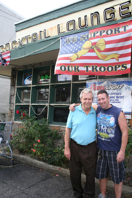 Jimmy Boyle, owner of The Den, and bartender Randy Dunn outside the 50-year-old bar on Sheridan Blvd. in Inwood.