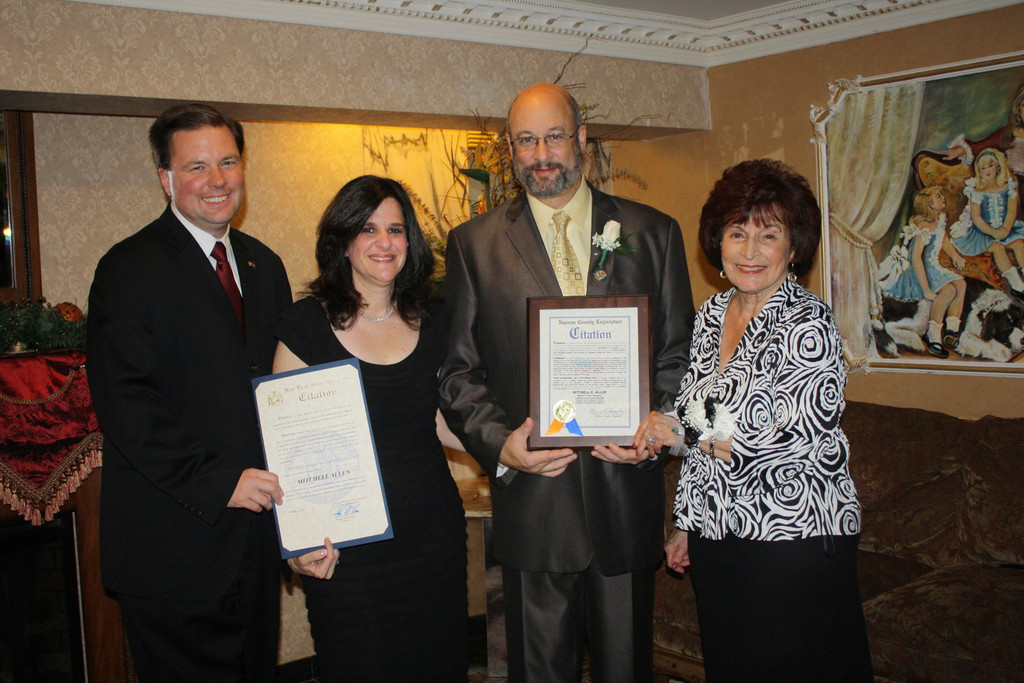 Past Kiwanis President Mitchell Allen, second from right, was honored by elected officials. Also pictured is Mitchell's wife, Karen.