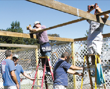 Temple Emanu-El members met on Sept. 23 and helped build one of the largest Sukkah structures in East Meadow.