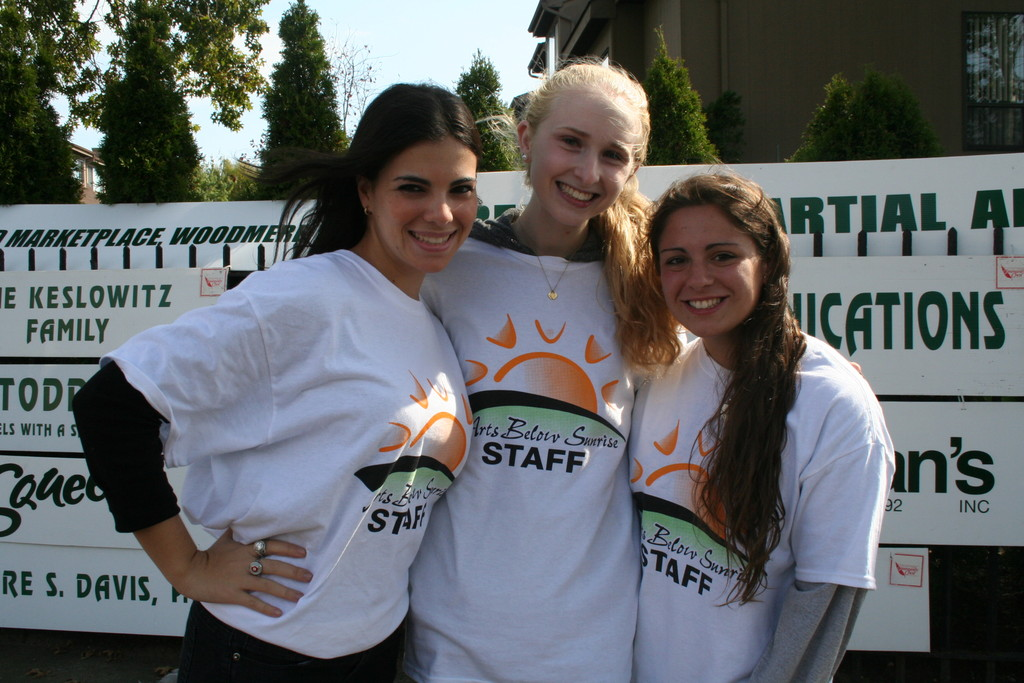 There were plenty of student volunteers to help Arts Below Sunrise run smoothly. From left, Hewlett High School seniors and student volunteers Margo Rieman, Emily Hagen and Nicole Sellino.