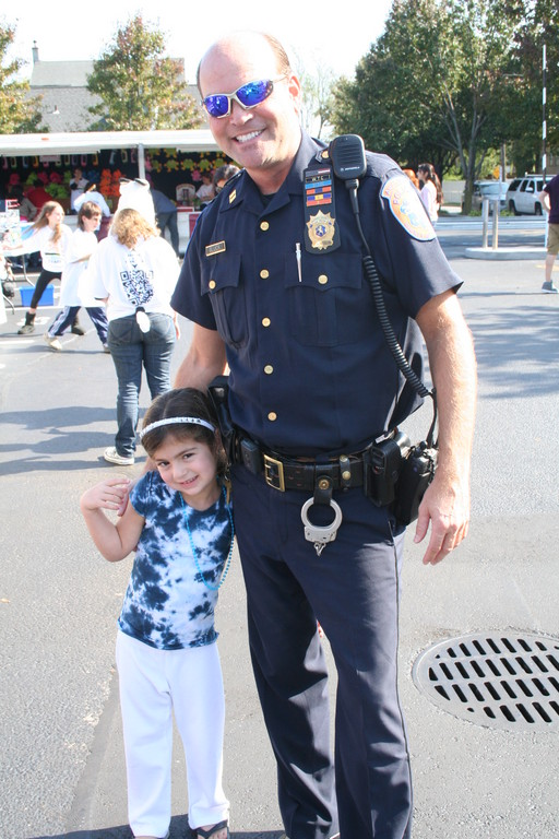 Though Captain Danny Gluck of the Five Towns Auxiliary Police Unit 109 was on duty at Arts Below Sunrise, he was able to spend time with his daughter Rylee, 3.