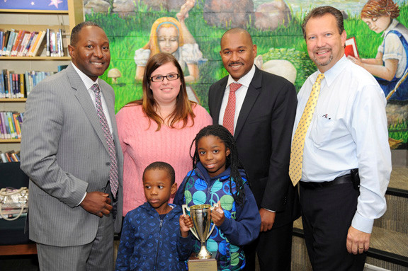 Clear Stream Avenue School took home the Waldinger Cup for the second year in a row. From left are Principal John Singleton, Children�s Librarian Jaclyn Kunz, Superintendent Dr. Nicholas Stirling and Mayor Ed Fare along with students Eduardo Mason, 5, and Kerisa Mason, 9.