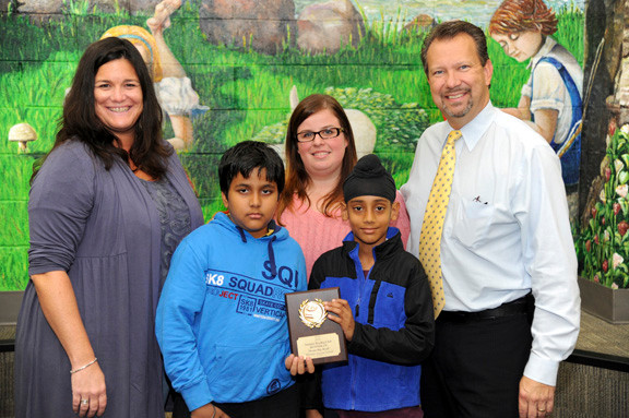 Wheeler Avenue School librarian Teresa Bolz, left, along with students Ankit Singh, 10, and Harnor Singh, 9, accepted the second-place award from children's librarian Jaclyn Kunz and Mayor Ed Fare.