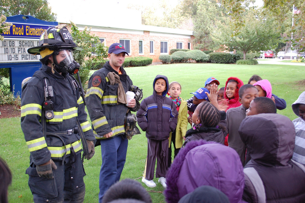Valley Stream Firefighters Tom McBride, left, and Ryan Mastrangelo showed students at the Forest Road School what their gear looks like.