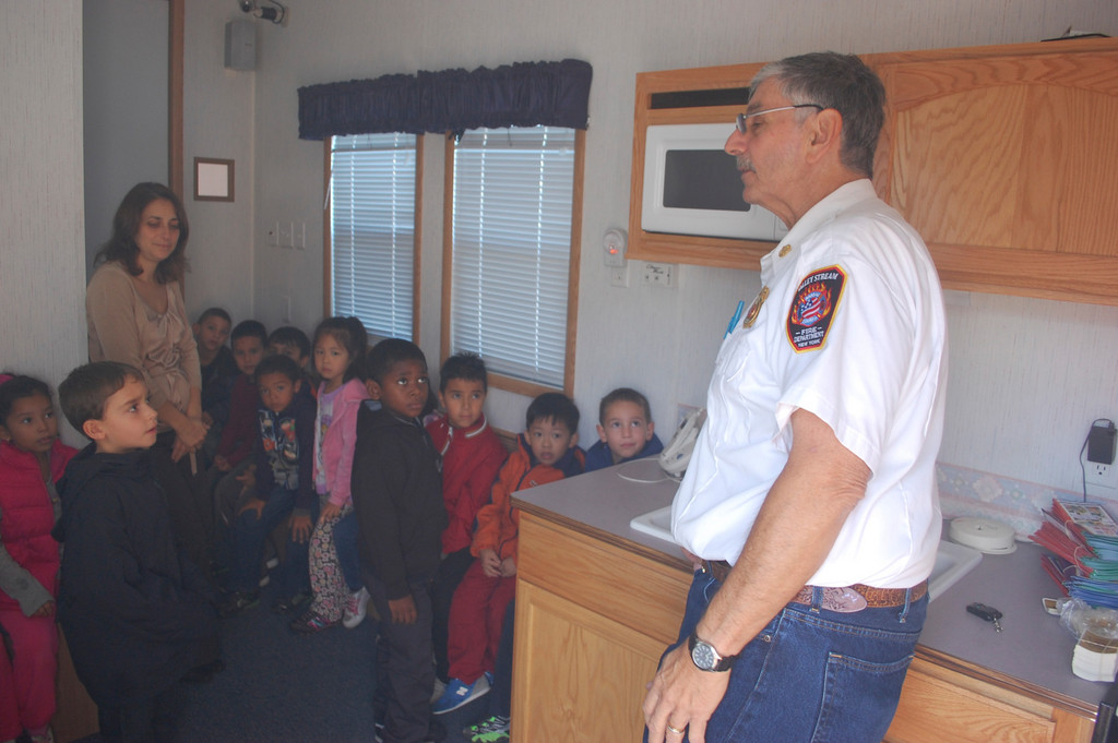 Ron Garofalo, a former Valley Stream fire chief, talked to students at the Carbonaro School about fire prevention in the home using the department's fire safety trailer.
