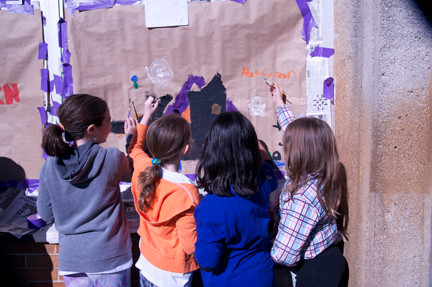 Brook Farrell, Sierra Levine, Daniella Moy and Victoria Parisette painted a spooky house on their window.