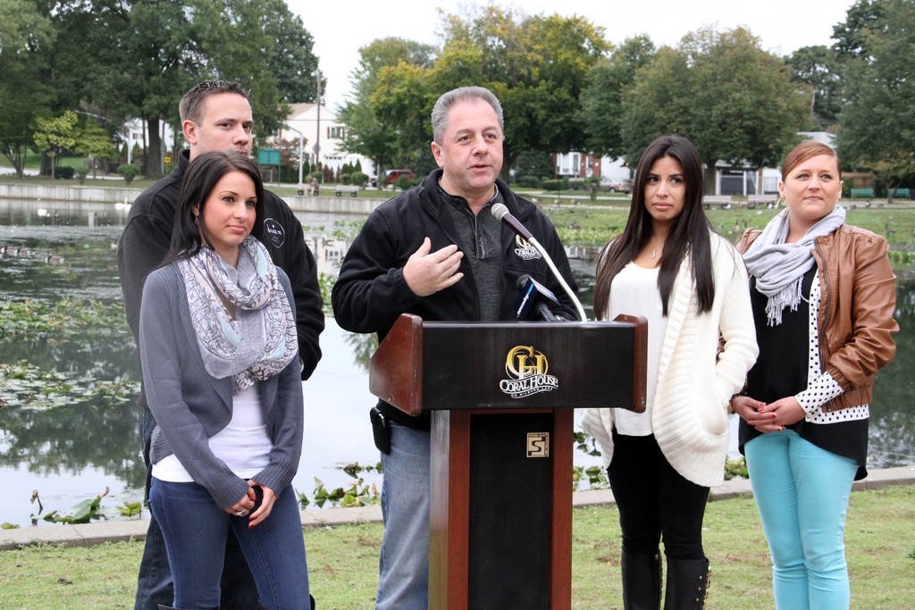 Butch Yamali,  at lectern, owner of the Coral House, appeared with staffers Brittany Musto, far left, Adam Panetta, Jill Ibarra and Jennifer Rickert to allay fears about 