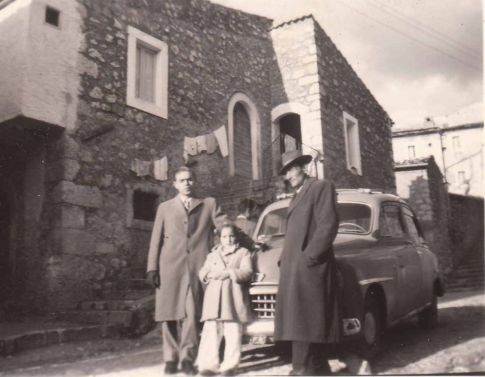 In 1955: Pictured with their Fiat were Arseno Baccari, Miss Mila Fabrizio, and Loreto Baccari in the town of San Donato Italy 
