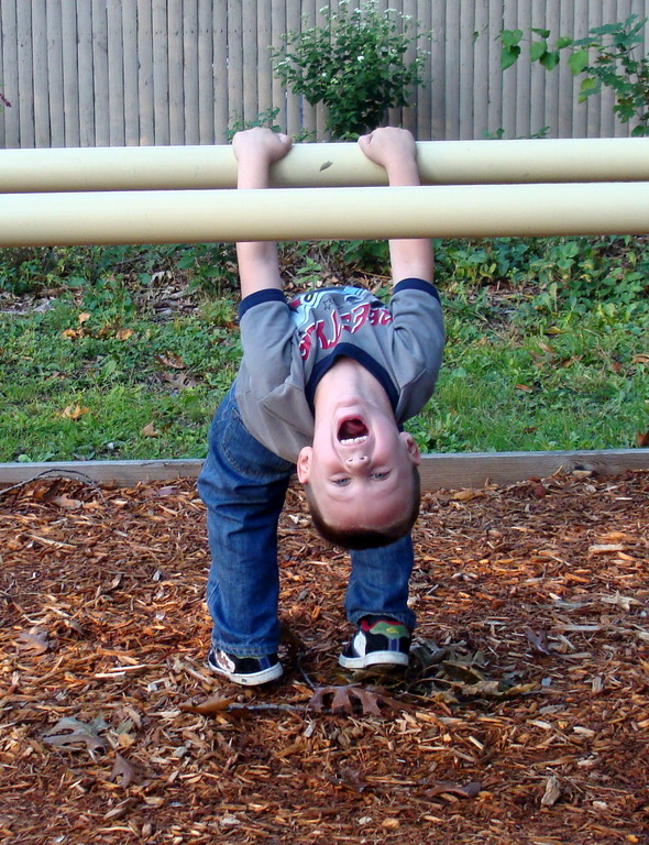 Shane practiced his stretching — and shouting — on the parallel bars.