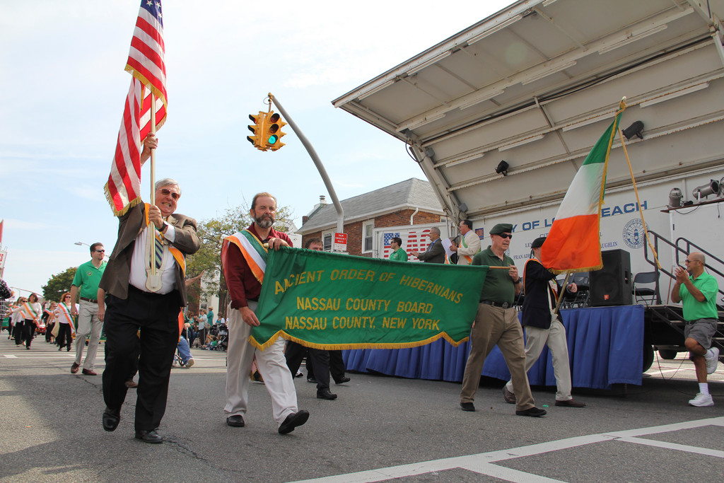 John O'Connell, in front at left, executive editor of the Herald Community Newspapers, was recently named the Nassau County Ancient Order of Hibernians Man of the Year. Above, O'Connell marching with the AOH Nassau County Board in Long Beach's St. Brendan the Navigator Irish Day parade.