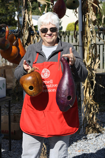 Farm Volunteer Nancy Youngfert showed off the handmade gourd birdhouses she made.