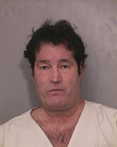 William Karas, 56, of East Meadow, was arrested after police say he pointed a loaded gun at a bartender.