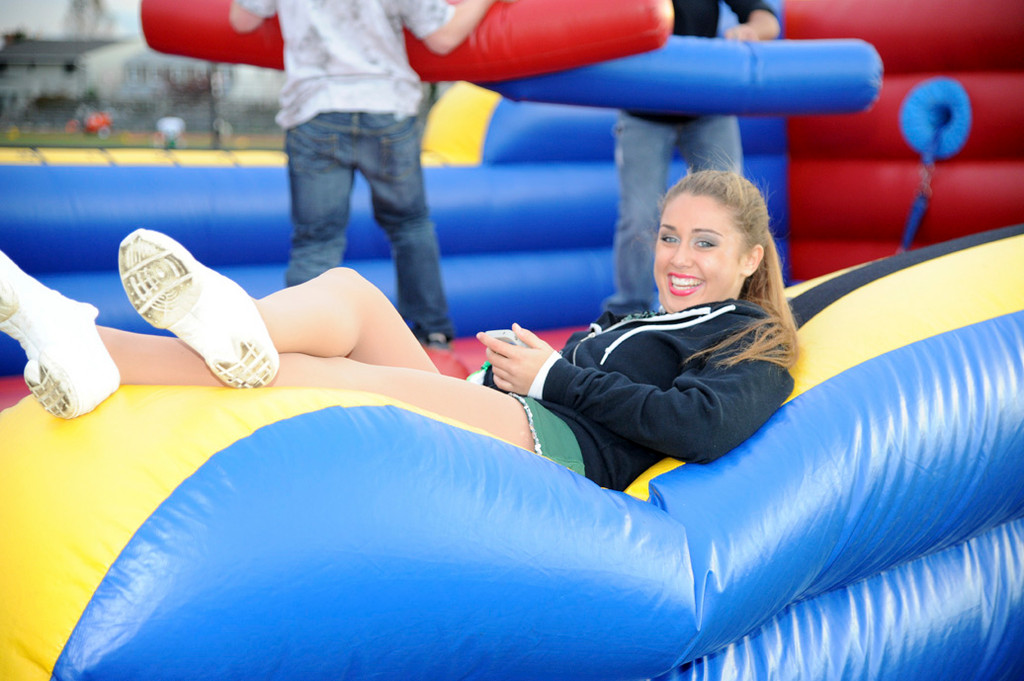 Olivia Johansen took a break on the inflatable slide, which was available with other carnival attractions at Friday's Homecoming festival.