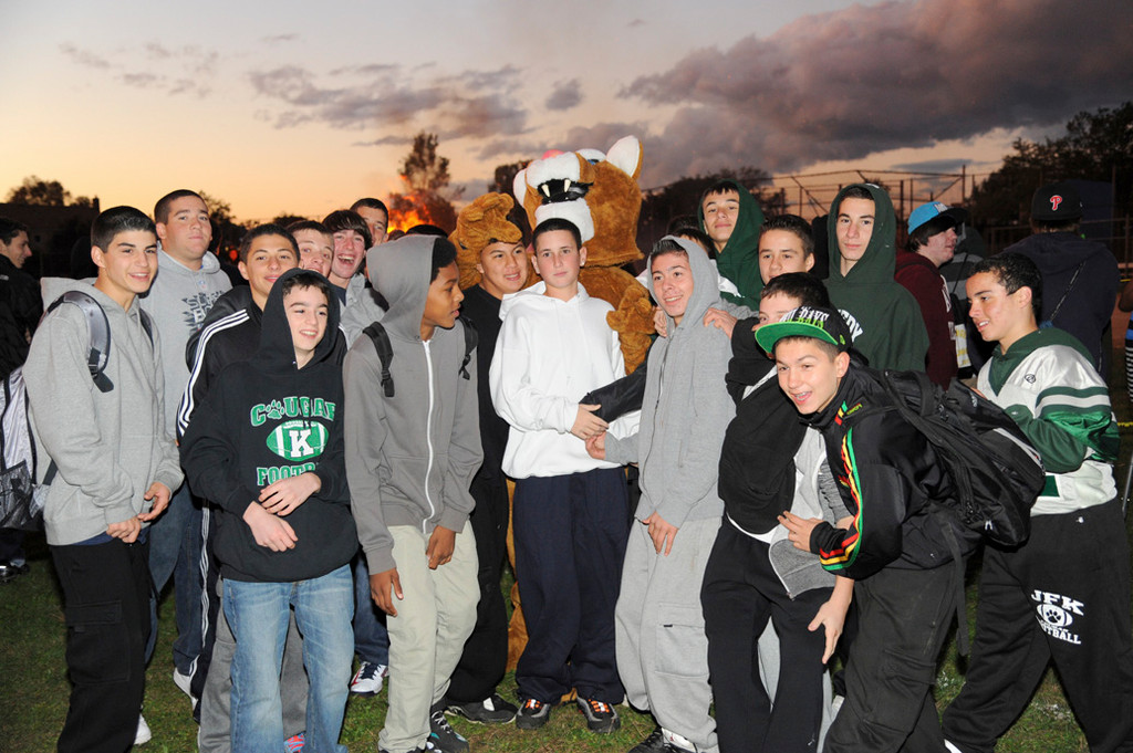 The cougar, Kennedy's mascot, posed for photos with students at the festival and bonfire.