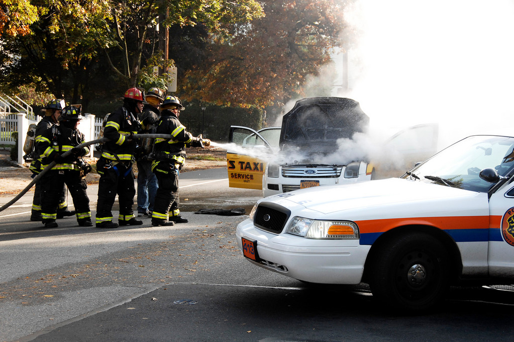 Hewlett firefighters put out the blaze that occurred when a taxicab's engine caught fire at the intersection of East Rockaway Road and Union Avenue in Hewlett.