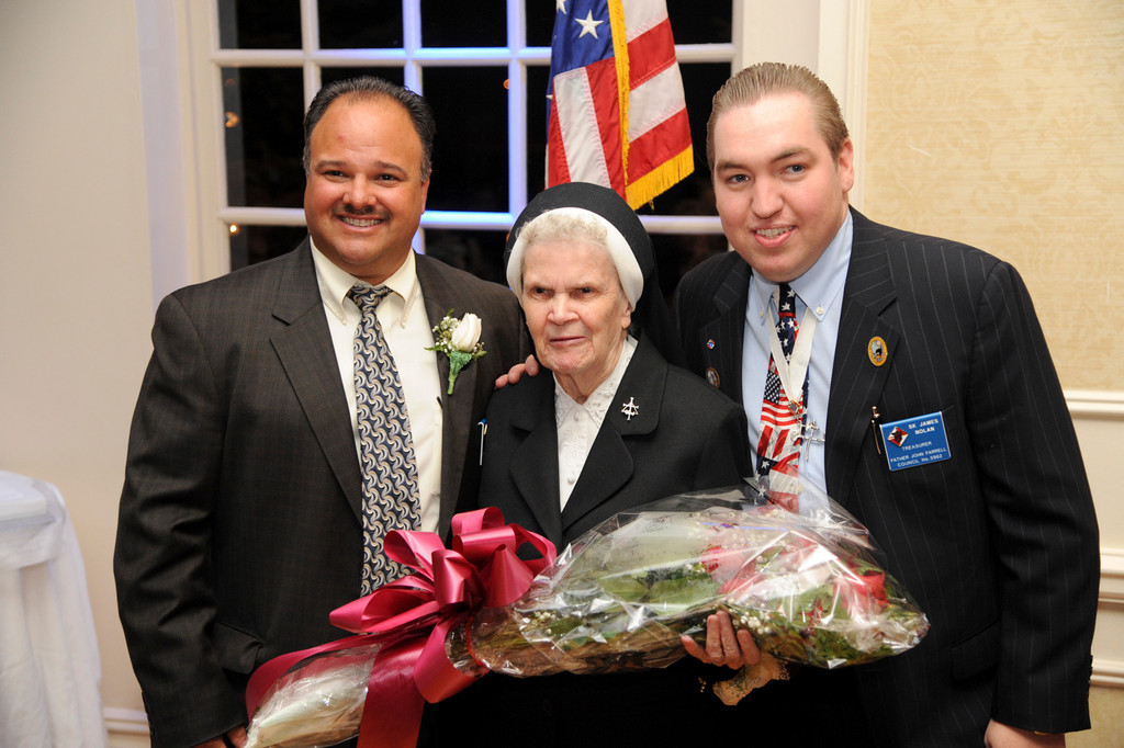 Father John Farrell Council of the Knights of Columbus held its annual dinner dance at the Coral House in Baldwin. From left were, honorees Joseph Lentini and Sister Mary Albert, along with James Nolan.