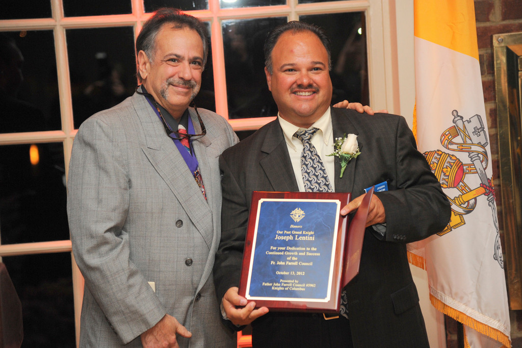 Current Grand Knight Peter Chiofolo presented most recent past Grand Knight Joseph Lentini with an award that recognized his service to the KoC.