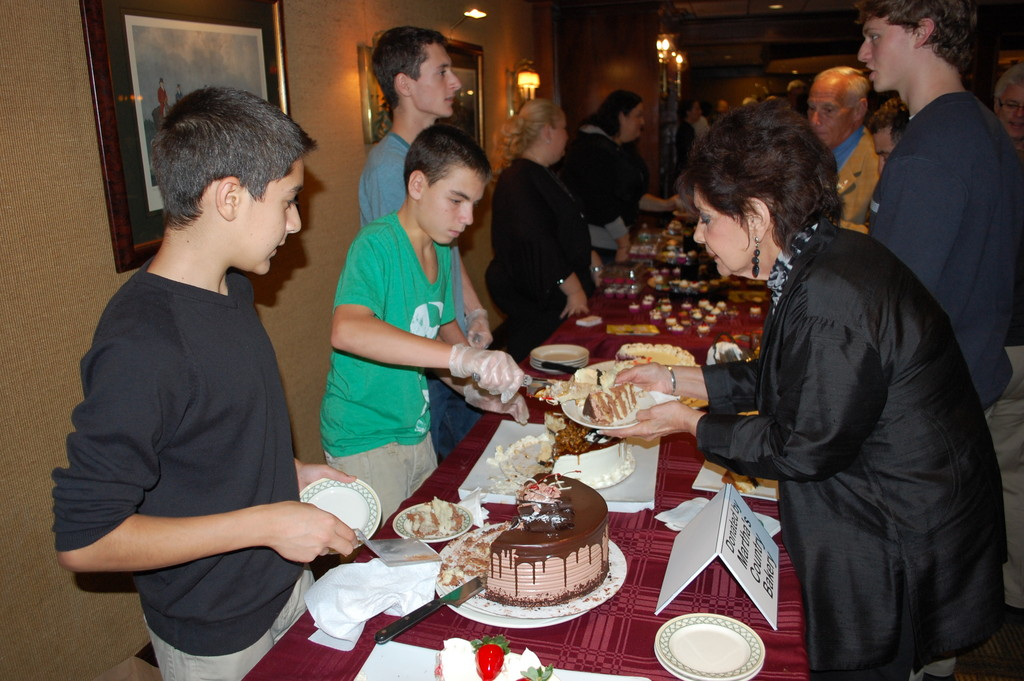 Dylan Isaacs and Jon Rosenbaum, students at Hewlett High School, helped served cakes from Martha's Country Bakery.