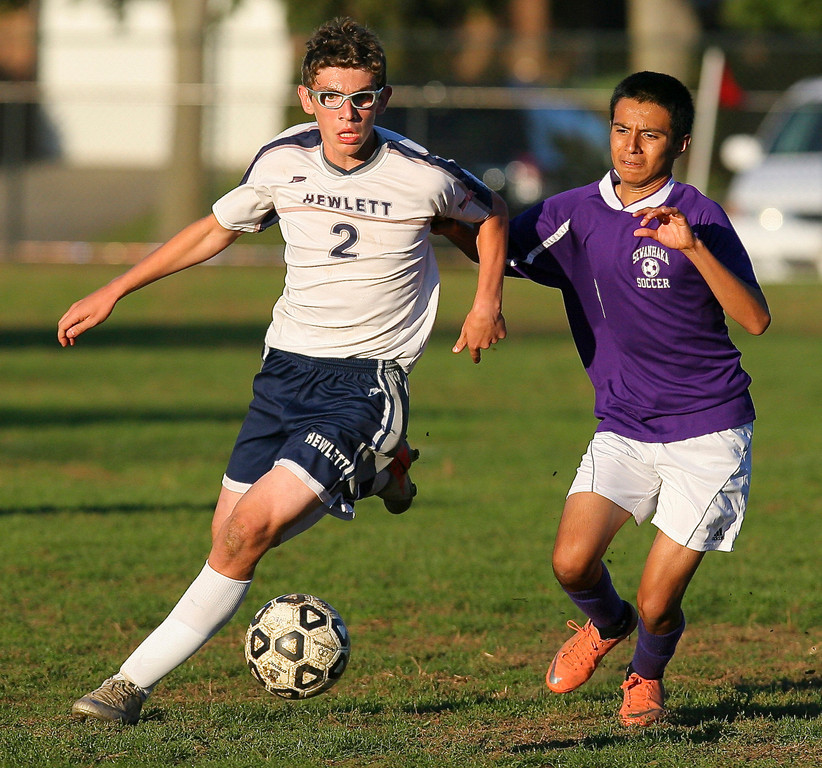 Hewlett's Spencer Feuer, left, had a step on Sewanhaka's Christian Torres during a recent scoreless tie in Conference A-V.