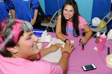 Nicole Lippold painted varsity football player Vin Vecchione�s nails at Central High School�s �Go Pink or Go Home� fair last Friday evening to raise money for breast cancer research.