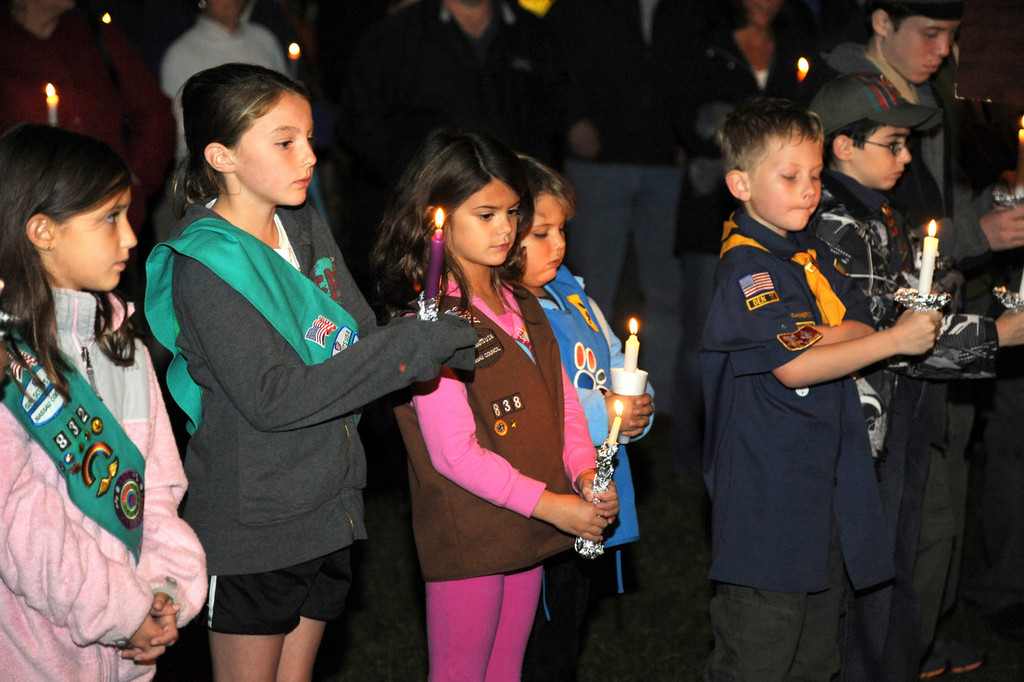 Members of the Boy Scouts, Girl Scouts and Cub Scouts led the Pledge of Allegiance.