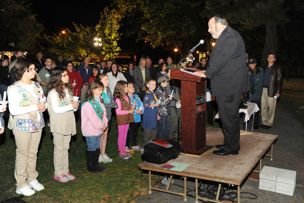 Rockville Centre Mayor Francis Murray addressed hundreds of residents gathered at the Village Green Sunday to pay their respects to the families who lost loved ones in the Sept. 11 terrorist attacks. The vigil also featured a short speech from State Sen. Dean Skelos.