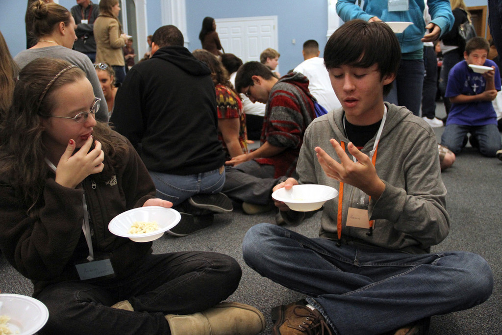 Amanda Clareen and Kevin McNaulty, part of the unlucky �havnots� eat their minimal rice dinner on the floor without utensils.