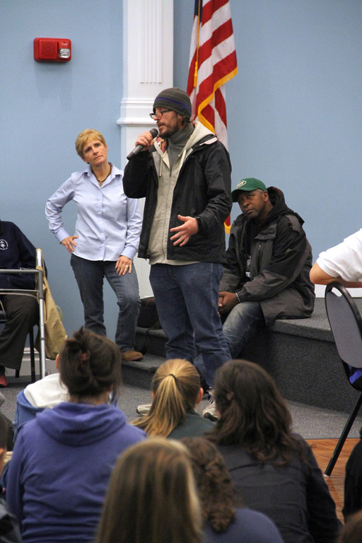Isa, a homeless man living in Manhattan, discusses his experience of being helped by the �Midnight Run� while Marianne Sheridan, Coordinator of Youth, Campus Ministry and Young Adults, Diocese of Rockville Centre and homeless man Malcolm look on.