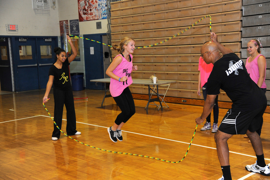 Meredith Nothel jumping rope with help from Liah Dewar and Dion Tulloch from iJump.