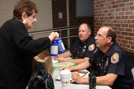 Gloria Christiano turned in unused medicine to Police Officers Bob Chimienti and Charlie Zanni during the 2010 event.