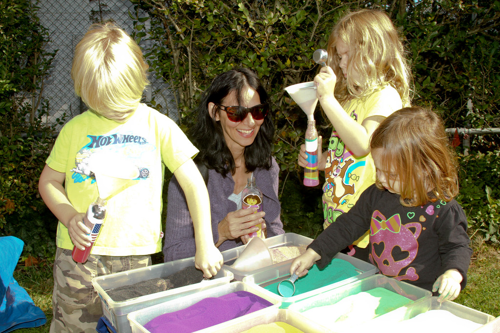 Rock Hall�s Country Fair included several family oriented activities. Debbie Ben and her children, twins Henry and Emma 5, and Lily 2, made sand art.
