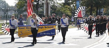 Students marched down East Meadow Streets, brandishing banners and showing off their school spirit.