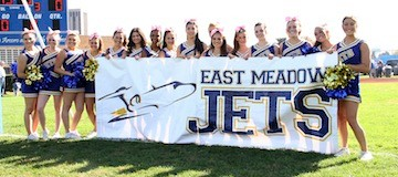 Varsity cheerleaders proudly presented the school's banner during the East Meadow High School Homecoming parade last Saturday.