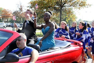 Homecoming King and Queen Dave Carey and Danielle Jean sat atop their mobile throne during East Meadow High School's annual Homecoming parade last Saturday.