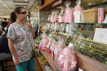 Dina Williams browsed the raffles. All proceeds from the day went to the Hewlett House 1 in 9 Breast Cancer Coalition