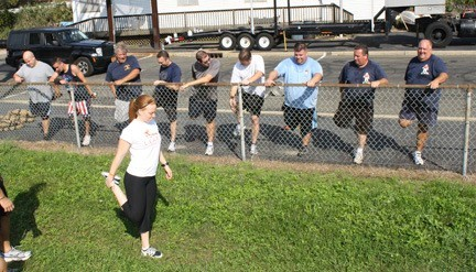 Baldwin firefighters were put through their paces by Lynbrook's Kristie Lengel, 23 of LEARN Fitness.