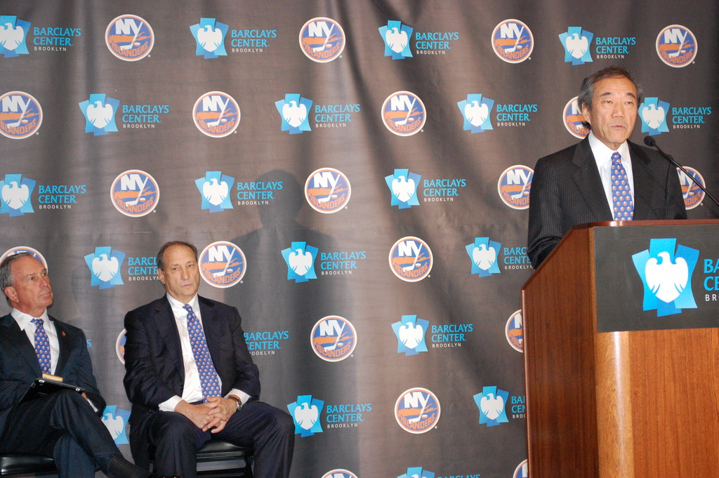 New York Islanders Owner Charles Wang, right, announced on Wednesday that his team will be leaving Nassau County in 2015 for Brooklyn. Pictured with Wang are New York City Mayor Michael Bloomberg, left, and Barclays Center Majority Owner and Developer Bruce Ratner.