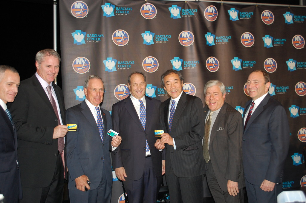 New York City Mayor Michael Bloomberg, third from left, presented New York Islanders Owner Charles Wang, third from right, and General Manager Garth Snow, second from left, with MTA Metrocards. Also pictured, from left, are Barclays Center CEO Brett Yormark, Barclays Center majority owner and developer Bruce Ratner, Brooklyn Borough President Marty Markowitz and National Hockey League Commissioner Gary Bettman.