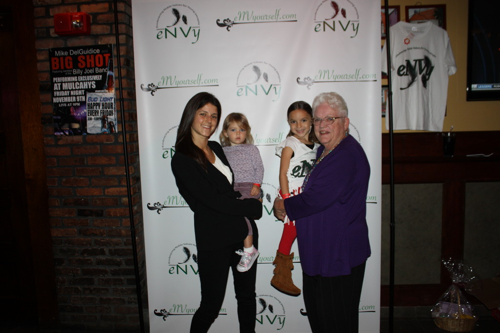 Nick Vacchio's cousin Amanda Legnetti with her daughter Olivia and Vacchio's grandmother Kathy Kane with his best friend Ashleigh Cruz's daughter Jazelle at the fundraiser.